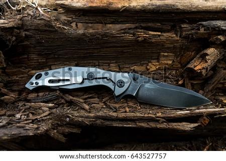 Folding knife with titanium handle. EDC knife.