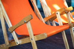 Folding wooden deckchair or beach chair. Armchair, Still life shot of two deck chairs on the beach