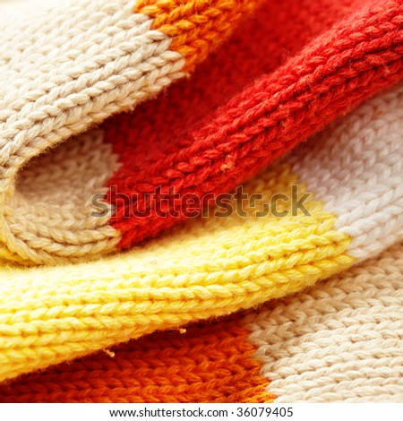 Folds of colour woolen sweater close up