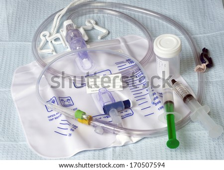 Foley catheter with drainage bag and patient name tag.