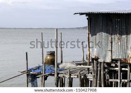 Folk house and folk ship on a quiet waterfront