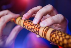 Folk musician in concert plays the melody on the Ethnic Flute