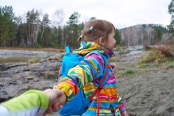 Follow me - Child daughter wanting her mother to follow her in travel or walk in wild nature