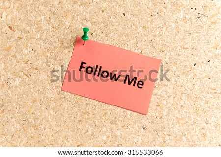 follow me word typed on a paper and pinned to a cork notice board
