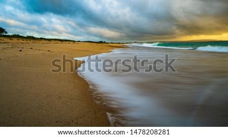 Follow the shoreline of the beach