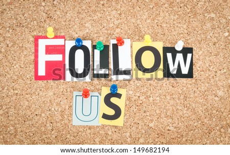 Follow Us pinned on cork bulletin board