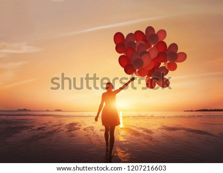 follow your dream, inspiration concept, silhouette of woman with colorful balloons on the beach #1207216603