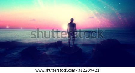 Follow your dreams, silhouette of man and many stars, rising sun on the beach, alien landscape- elements of this image are furnished by NASA
