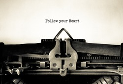Follow your Heart  message typed on a vintage typewriter