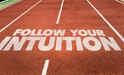 Follow Your Intuition written on running track