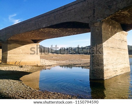 Folsom lake bridge exposed during drought of 2013-2014 #1150794590