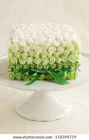 Fondant rose wedding cake - stock photo