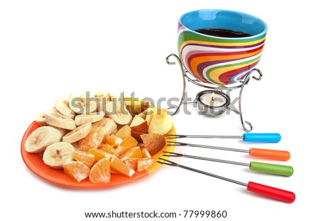 fondue cup and plate with fruits isolated on a white background