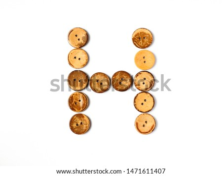 "Font H, Alphabet ""H"" made from Buttons from Coconut shell on white background #1471611407"