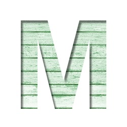 Font on an old wooden wall. The letter M cut out of paper on the background old wood wall with peeled green paint. Set of decorative fonts.