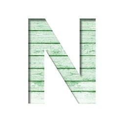 Font on an old wooden wall. The letter N cut out of paper on the background old wood wall with peeled green paint. Set of decorative fonts.