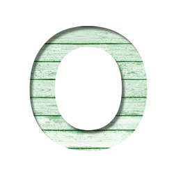 Font on an old wooden wall. The letter O cut out of paper on the background old wood wall with peeled green paint. Set of decorative fonts.
