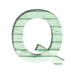 Font on an old wooden wall. The letter Q cut out of paper on the background old wood wall with peeled green paint. Set of decorative fonts.