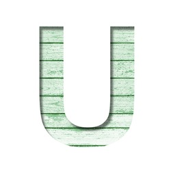 Font on an old wooden wall. The letter U cut out of paper on the background old wood wall with peeled green paint. Set of decorative fonts.