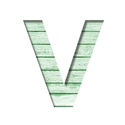 Font on an old wooden wall. The letter V cut out of paper on the background old wood wall with peeled green paint. Set of decorative fonts.