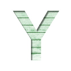 Font on an old wooden wall. The letter Y cut out of paper on the background old wood wall with peeled green paint. Set of decorative fonts.