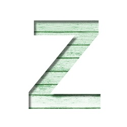 Font on an old wooden wall. The letter Z cut out of paper on the background old wood wall with peeled green paint. Set of decorative fonts.