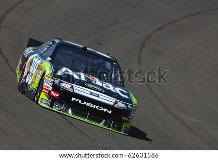 FONTANA, CA - OCT 08, 2010:  Carl Edwards brings his AFLAC Ford Fusion through the turns during a practice session for the Pepsi Max 400 race at the Auto Club Speedway in Fontana, CA on Oct 8, 2010.