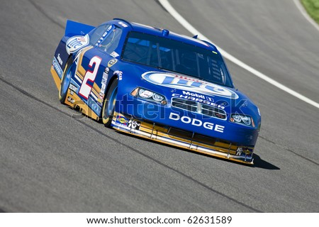 FONTANA, CA - OCT 08, 2010:  Kurt Busch brings his Miller Lite Dodge through turn 4 during a practice session for the Pepsi Max 400 race at the Auto Club Speedway in Fontana, CA on Oct 8, 2010.