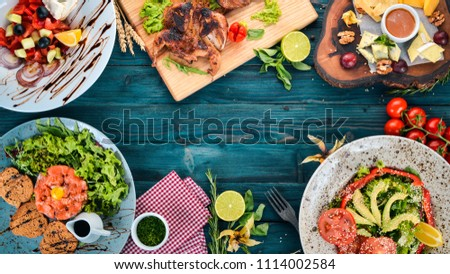 Food. A set of delicious dishes and delicacies. On a wooden background. Top view. Copy space.