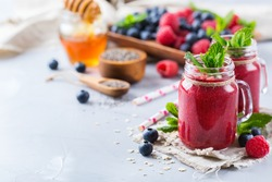 Food and drink, healthy lifestyle, diet and nutrition concept. Mixed smoothie for breakfast with berries, blueberry, raspberry, chia seeds, almond and oat vegan milk. Copy space background