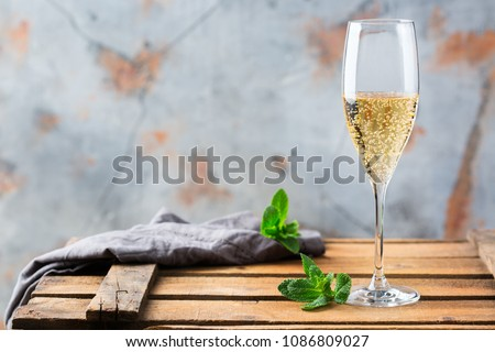 Food and drink, holidays party concept. Cold fresh alcohol beverage champagne sparkling white wine with bubbles in a flute glass on a wooden table. Copy space background #1086809027