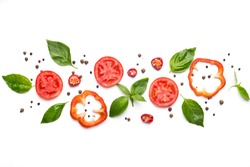 Food art. Creative composition of cut pepper, tomato, basil leaves and spices on white background, top view