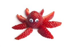 Food art creative concepts. Funny octopus made of strawberries isolated on white background.
