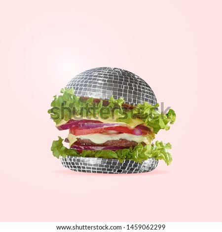 Food as fast as a disco dance. A burger as an discoball with salad, potato and meat. Negative space to insert your text. Modern design. Contemporary art collage. An alternative view of street food.
