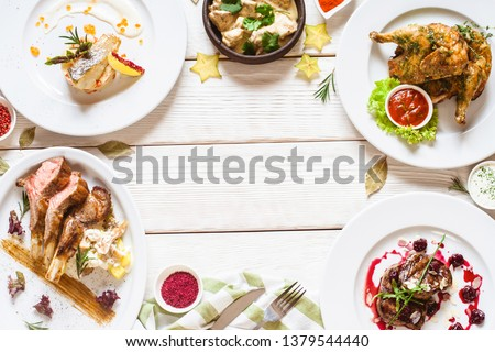 Food assortment top view. Restaurant meals flat lay. Table full of meat delicatessen. Buffet selection. Party catering dishes