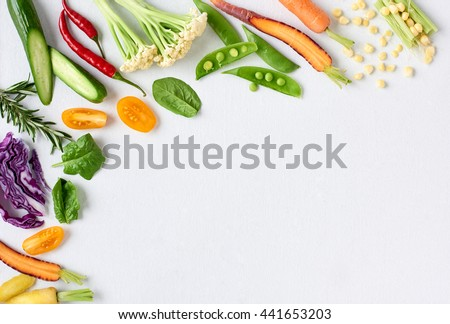 Food background border frame of colorful fresh produce raw vegetables, corn carrot chilli cucumber purple cabbage spinach rosemary herb, plenty of copy-space #441653203