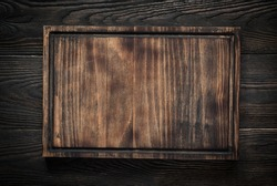 Food background. Cutting board on dark wooden table. Copy space.