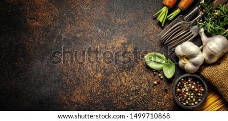 Food background. Italian cuisine. Ingredients on dark  brown background. Cooking concept. Cooking background. Banner Stok fotoğraf ©