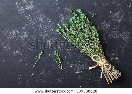 Food background of herb thyme on black kitchen table from above Stock photo ©