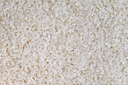 food background - short grains of uncooked white italica rice