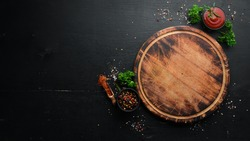 Food background. Spices, herbs and kitchen tools. Top view. free space for your text. Rustic style.