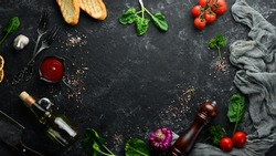 Food background. Vegetables, spices and herbs on the kitchen table. Top view. Free space for your text.