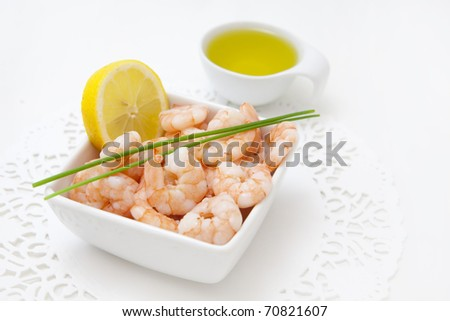 food background with fresh shrimps and lemon