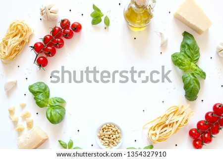 Food background with traditional ingredients for mediterranean cuisine over white background. Top view with copy space. Italian food, concept.