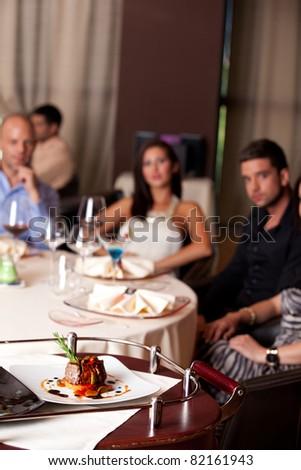food being served elegant people restaurant table