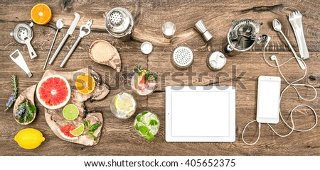 Food blogger desk with bar tools, accessories and electronic devices. Flat lay background