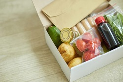 Food box meal kit of fresh ingredients and recipe blank order from a meal kit company, delivered, cooking at home.