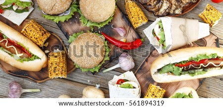 Food Buffet Catering Dining Eating Party Sharing Concept. Festival. All kinds of fast food. hot dogs, hamburgers, traditional American food. fast food, Oktoberfest, #561894319