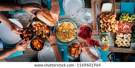 Food Catering Cuisine Culinary Gourmet Buffet Party Concept with lot of hands taking food from various mixed place on the table. having fu. community leisure activity at home or restaurant Сток-фото ©