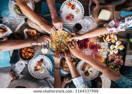 Food Catering Cuisine Culinary Gourmet Party Cheers Concept friendship and dinner together. mobile phones on the table, pattern and background colorful image with people eating taking food at events